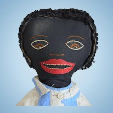 Antique Black Cloth Folk Art Doll with Embroidered Face