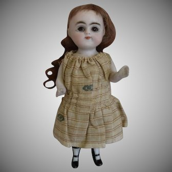 Antique German All Bisque Doll with Round Face and Sleep Eyes