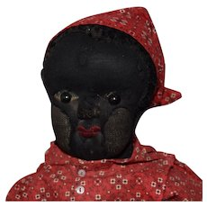 Black Stockinet Beecher Type Cloth Doll in Red Print Dress