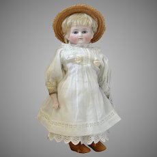 Early Solid Dome German Bisque Closed Mouth Shoulderhead Doll with Leather Body