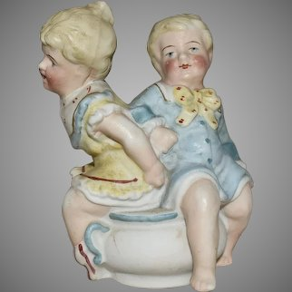 All Bisque Antique German Comic Figurine with Two Character Children on a Potty