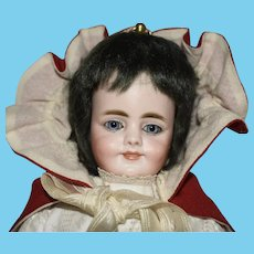 German Bisque Carl Bergner and Simon & Halbig Socket Head Two Face Doll in Red Riding Hood Cape
