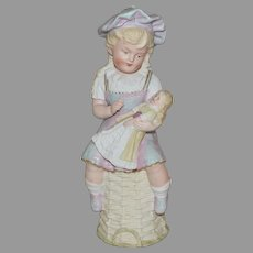 Gebruder Heubach Figurine All Bisque Seated Girl Holding a Doll