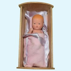 Painted Bisque Baby Doll in Original Maple Wood Cradle with the Original Box