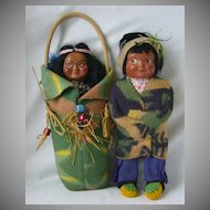 A Pair of Native American Cloth and Composition Dolls