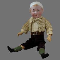 Recknagel German Bisque Head Character Boy With A Molded Bonnet