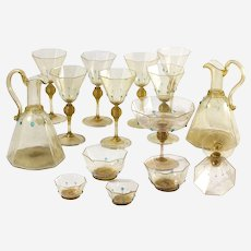 An amazing 15 piece C.1925 Salviati Octagonal Wine Set with gold flecks and decorated with swirled bulbs and applied blue drops.