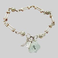 Charming Vintage Sterling Silver Bracelet with Shield Padlock and Key