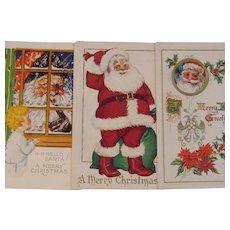Three Vintage Santa Postcards