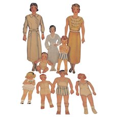 9 Paper Dolls Including a Paper Doll Baby from the 30's