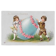 EAS Embossed German Easter Postcard Children Rolling and Egg with Pink Rose Garland