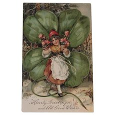 Girl with Huge Shamrock and Pink Flowers Embossed German Postcard Unused