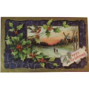 German Embossed Christmas Postcard with Winter Windmill Scene, Holly and Bird Purple and Gold Background Germany