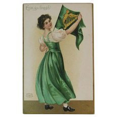 German St. Patrick's Day Embossed Postcard Erin Go Bragh Pretty Lady with Flag from International Art Publishing Co
