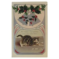 1909 Helena Maguire Christmas Cat Playing Dominoes Postcard Embossed Holly and Bells Edwardian Era New Year Kitty Kitties German Germany