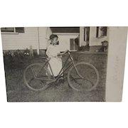 1910 Real Photo Postcard of a Girl and Her Huge Bike RPPC
