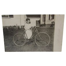 1910 Real Photo Postcard of a Girl and Her Huge Bike RPPC