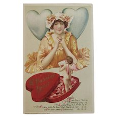 1914 Winsch Valentine Embossed Postcard Lady with Heart Box of Chocolates and Cherub