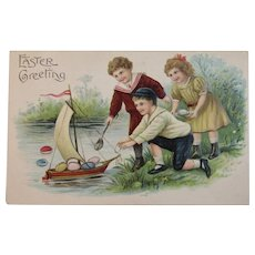 ASB German Embossed Easter Postcard Children with Boat Full of Eggs Sailboat