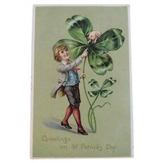 Tuck Boy with Pig in Four Leaf Clover Embossed St. Patrick's Day Postcard Tuck's