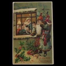 1910 German Blue Robe Santa Christmas Postcard Embossed Looking in Window at Family