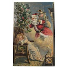 Santa and Sleeping Child Merry Christmas Embossed Postcard Unused Embossed - Red Tag Sale Item