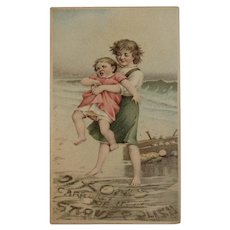 1889 Dixon's Carburet of Iron Stove Polish Victorian Trade Card Girls at Beach with Doll Words in Waves