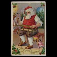 1912 Santa Making Sled in Workshop Embossed Christmas Postcard