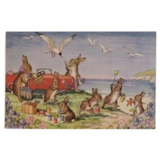 Molly Brett A Day By The Sea Postcard Unused Medici Society Bunnies Picnic at the Beach with Convertible Car
