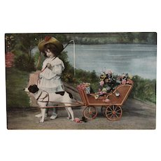 Girl with Dog Pulling Flower Cart Postcard Unused Edwardian Era