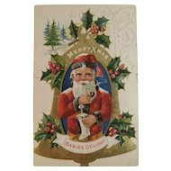 1912 Santa Babies Delight Embossed Postcard with a Stocking Pipe Holly and Bell
