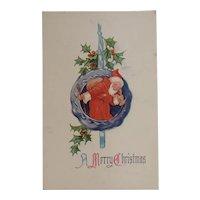Santa in an Ornament Unused Embossed Postcard