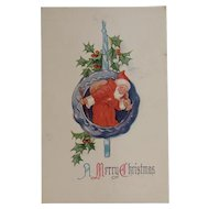 Santa in an Ornament Unused Embossed Postcard