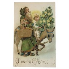 Green Robe Santa Riding a Donkey with Girl and Tree Embossed Christmas Postcard