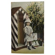Tinted Real Photo Gel Christmas Postcard cool Boy in Party Hat with Tree