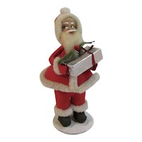Vintage Santa Claus Figurine on Paper Mache Base Holding a Present. Made in Japan