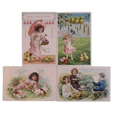 4 Raphael Tuck & Sons German Easter Embossed Postcards Girls in Easter Bonnets and Dresses Flowers Bunnies Chicks Eggs