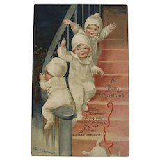 German Clapsaddle Signed Christmas Postcard with Snowbabies Children Sliding Down the Banister Series 1897 IAP International Art Publ Co