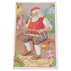 Santa Making a Sled in the Workshop Unused Embossed Postcard