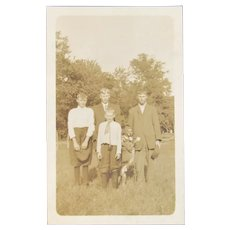 Vintage Photo of Dog on Hind Legs with Boys and their Father