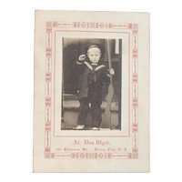 1918 Photo of a Little Boy in a US Navy Sailor Suit with Wood Gun Saluting