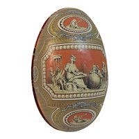 Tin Litho Easter Egg Candy Container with Classical Motif Cherubs Greek Roman Ruins Ornate Design