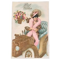 Edwardian Postcard Lady in Roadster Car Driving with Basket of Flowers Unused Embossed