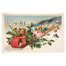 German IAP Teddy Bear Driving Sled with Doll Children Toys Xmas Limited Christmas Postcard Germany Embossed Unused