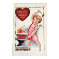 1916 Cupid Blacksmith Valentine Postcard Valentine's Day Hearts Repaired Here