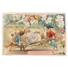 Liebig Victorian German Trade Card with Gnomes and Fairies for Fleisch Meat Extract Recipe on Back Woodland Scene Pushing Wheelbarrow