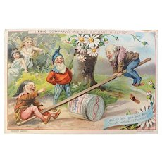 Liebig Victorian German Trade Card with Gnomes on a Teeter Totter and Fairies Fleisch Meat Extract Recipe on Back Woodland Scene