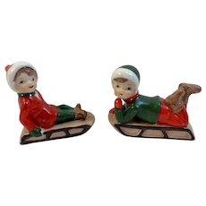 2 Bisque Children on Sleds Boy Girl Sledders Vintage Christmas