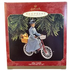 1997 Miss Gulch Wizard of Oz Hallmark Christmas Keepsake Ornament with Toto in Basket on Bike