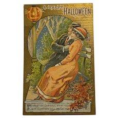 1912 Halloween Postcard Couple on Park bench Looking at JOL Lamp Post Jack O Lantern Romantic Embossed